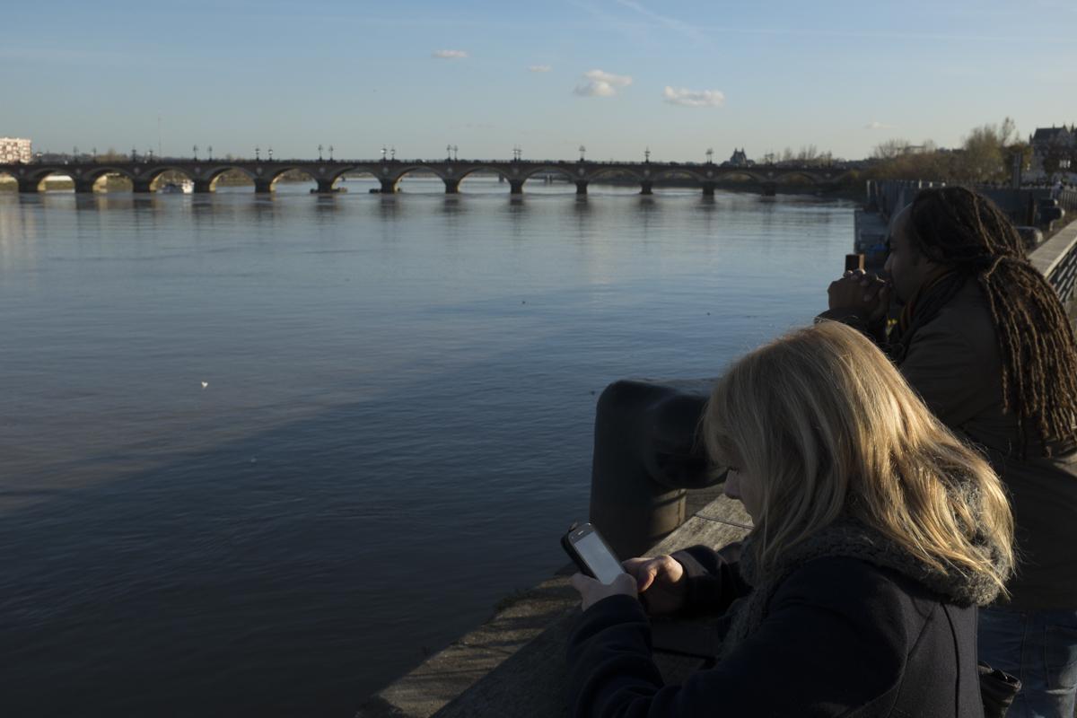 Standing along Pont de Pierre. Anaïs seems enthused.