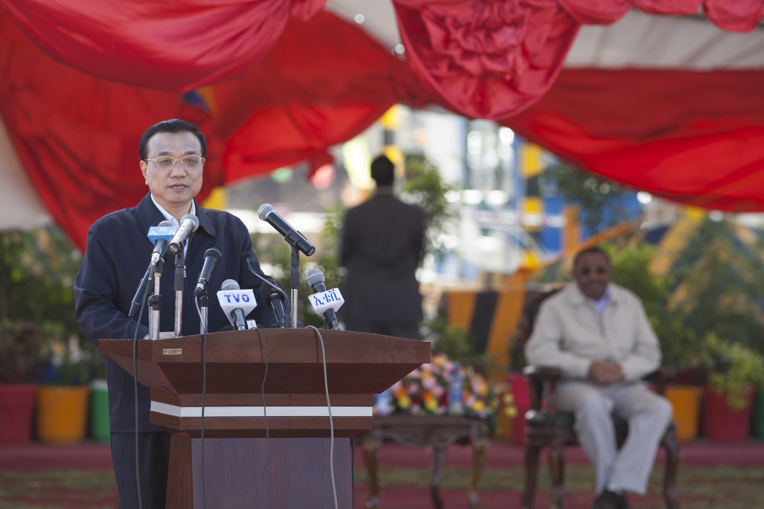 Li Keqiang, Chinese Prime Minister Li Keqiang gives a speech at the site of the Addis Ababa Adama toll road on May 5, 2014, after he christened the site. Li arrived in Ethiopia for the start of a four-nation African tour, his first visit to the continent since assuming his position a little over a year ago