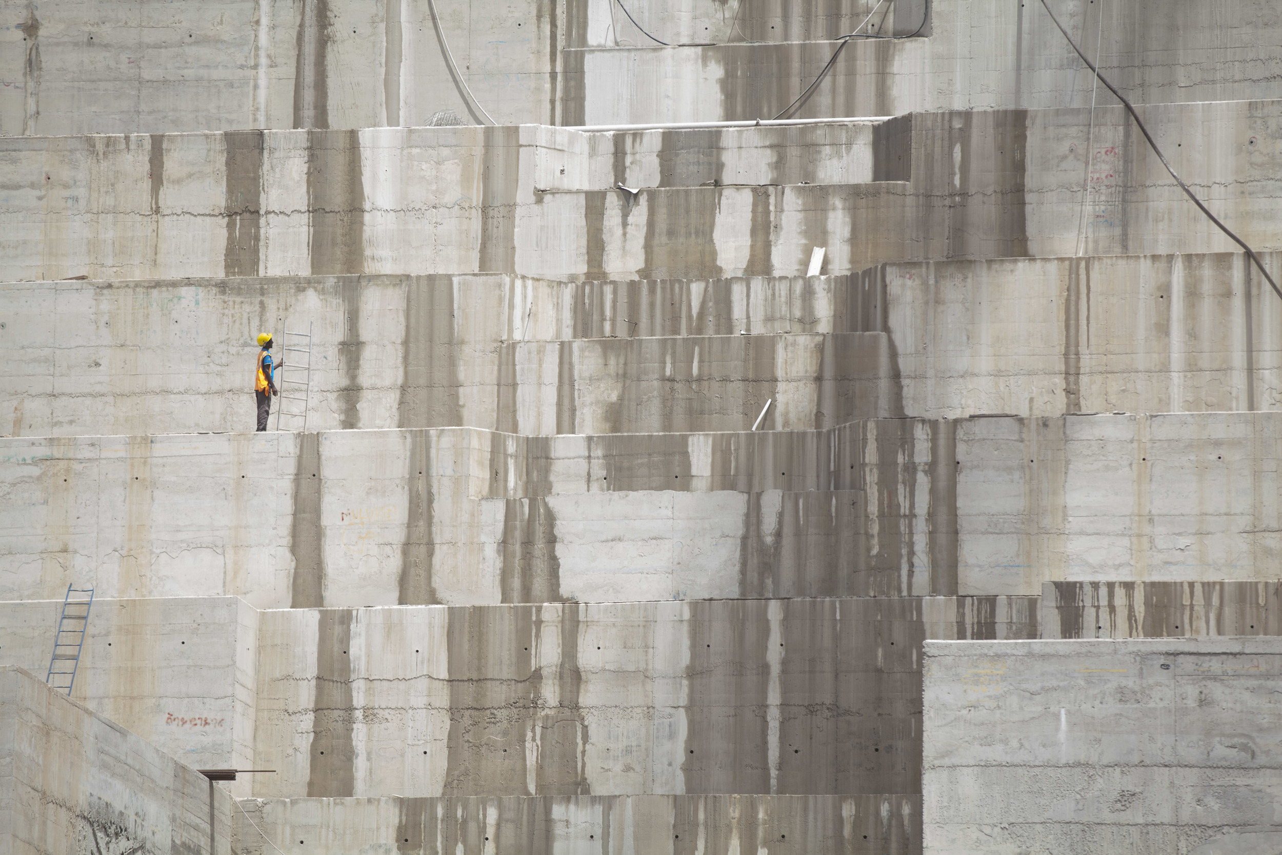 Ethiopian workers are pictured on site at the Great Ethiopian Renaissance Dam on 31 April 2015. Once completed the Ethiopian Dam, and the biggest in Africa will produce around 6000 MW of power, both for export and internal use. AFP Photo / Zacharias Abubeker