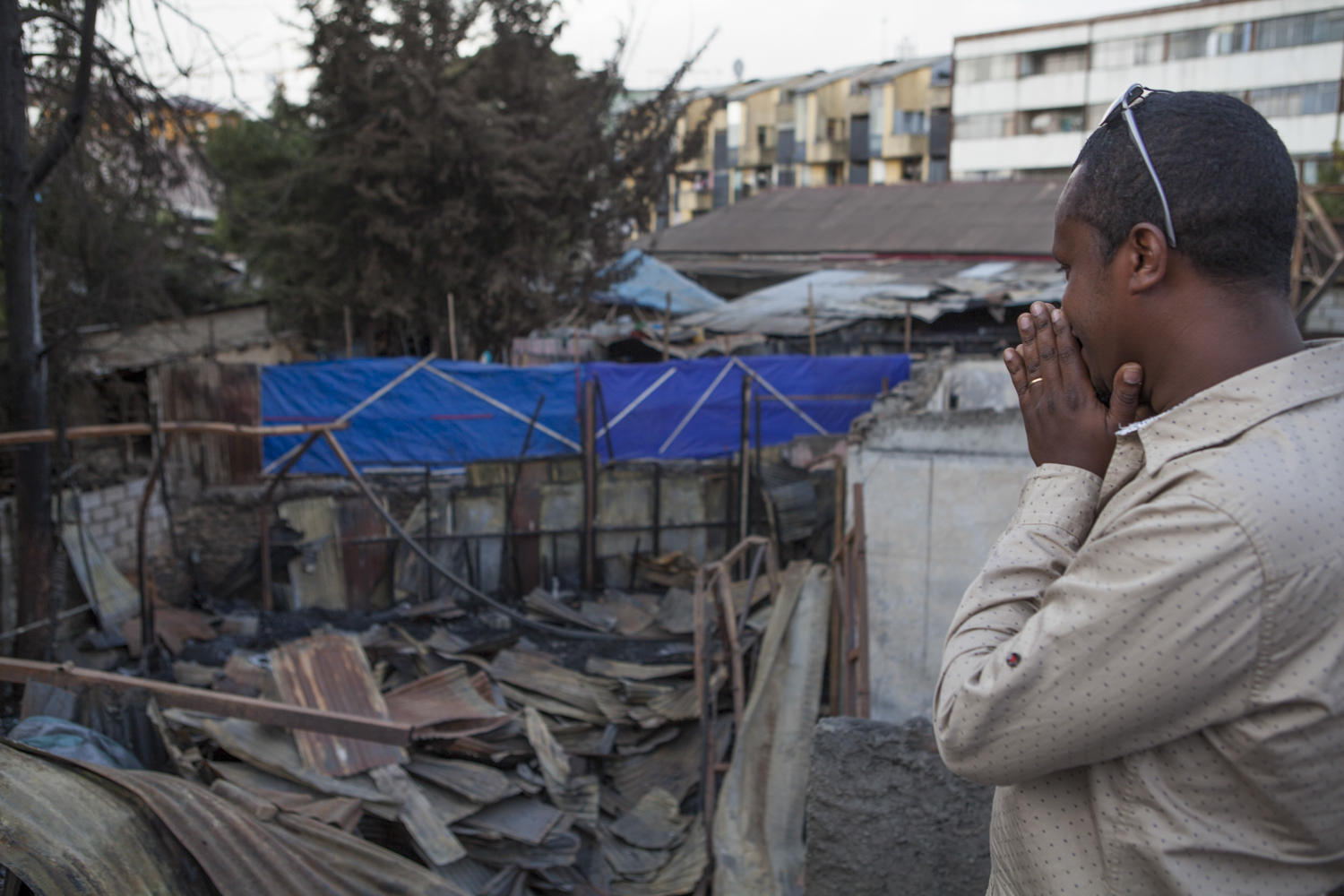 Misale Legesse, an Ethiopian jazz drummer, is pictured on 16 Feb 2015 surveying the damage from the fire that ripped through Jazzamba, a jazz club in Addis Ababa, in mid Jan 2015. The club was inside the oldest hotel in the country, Taitu, which was established in the early 20th century by Empress Taitu of Ethiopia. AFP Photo / Zacharias Abubeker