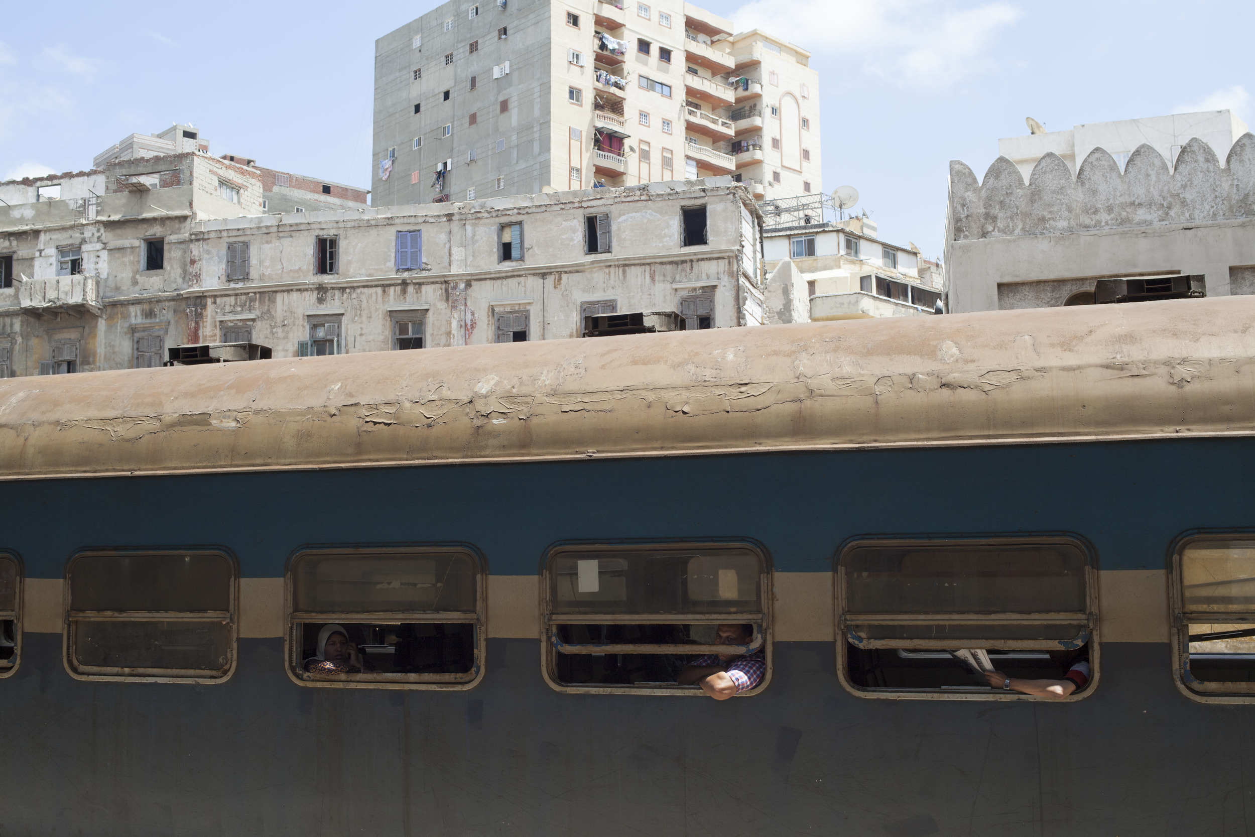 People wait for a train to depart in Alexandria Central.