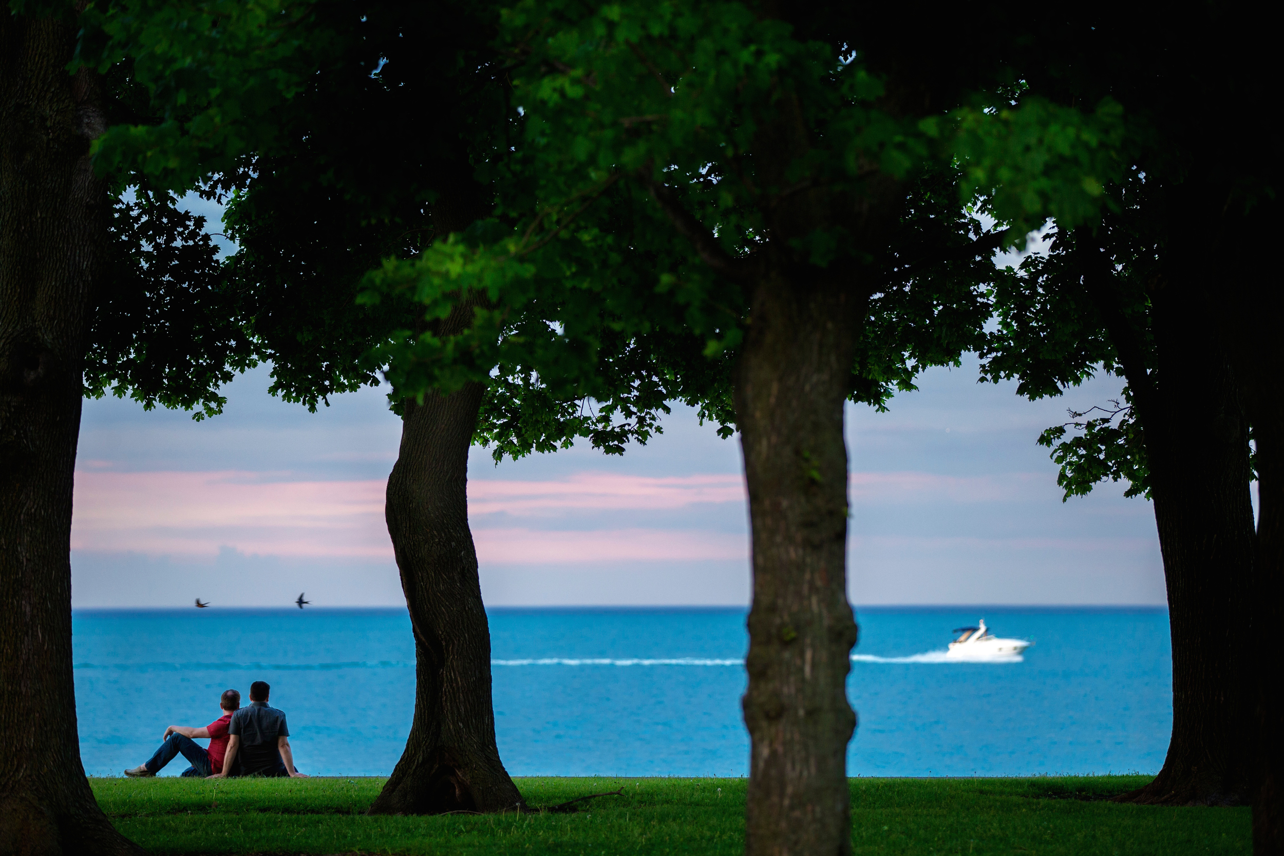 couple-watches-boat-go-by-at-belmont-harbor-chicago-lake-michigan.jpg