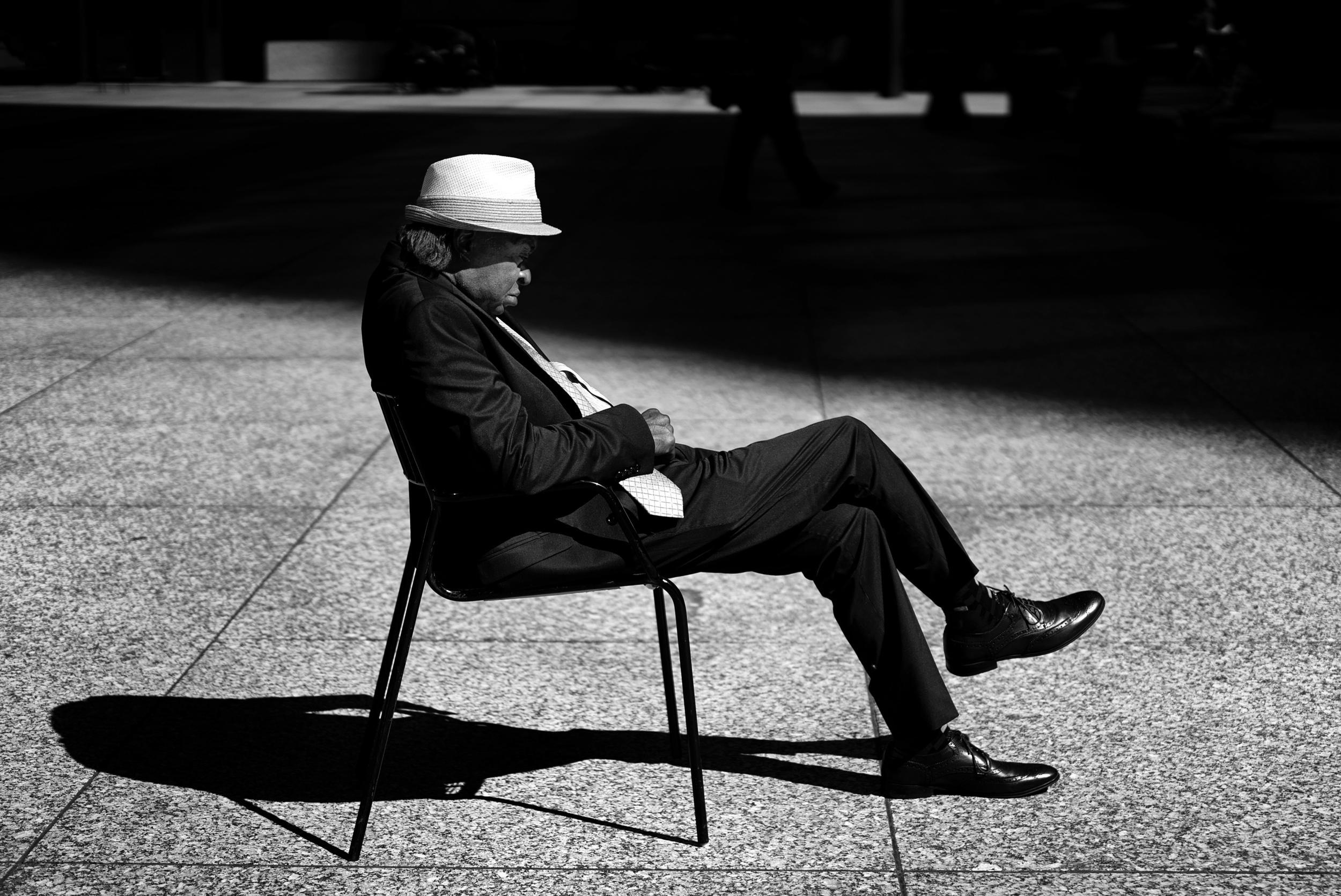 man-sleeping-daly-center-plaza-chicago.jpg