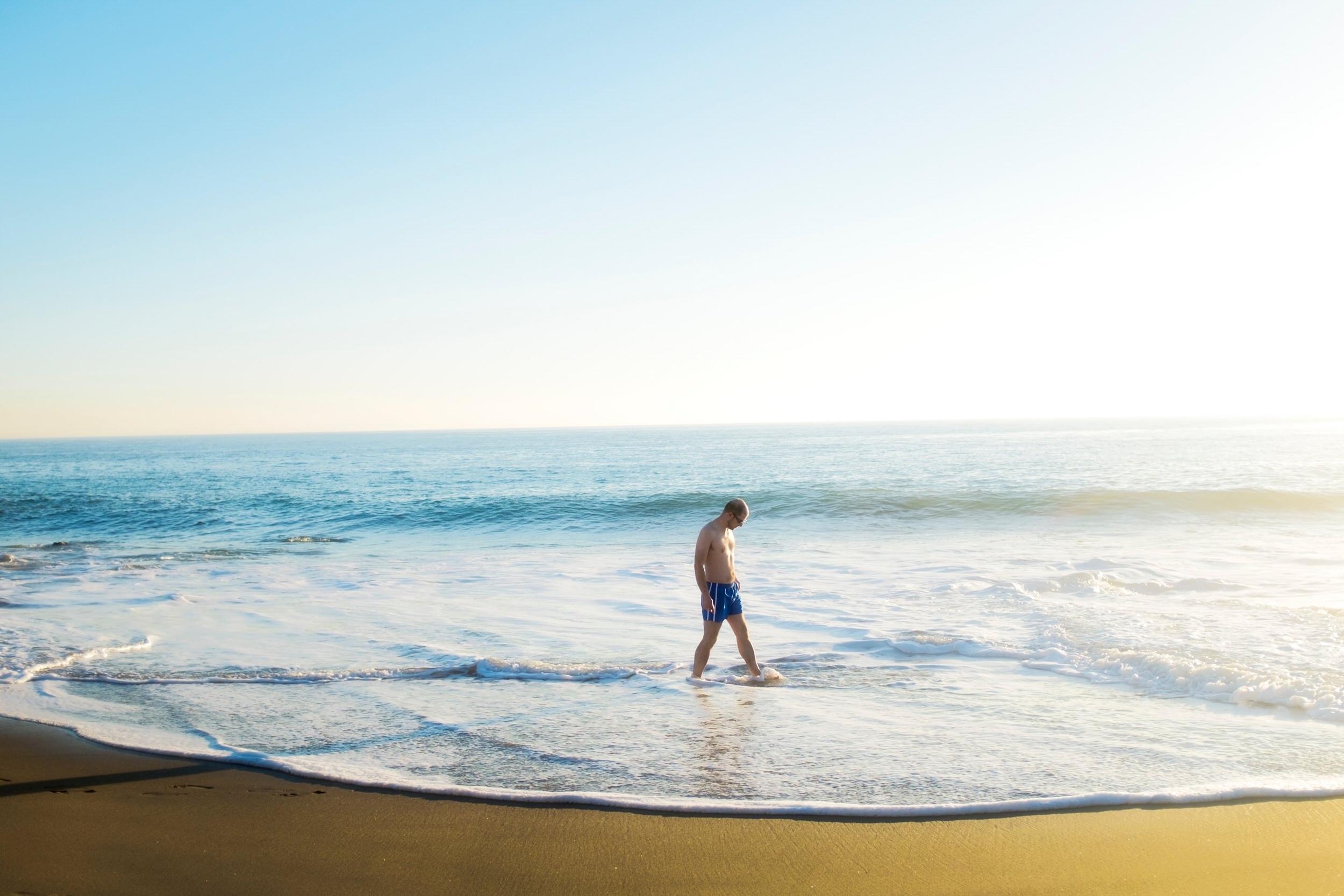 man-walks-aling-leo-carillo-beach-on-a-warm-thanksgiving-day-in-malibu.jpg