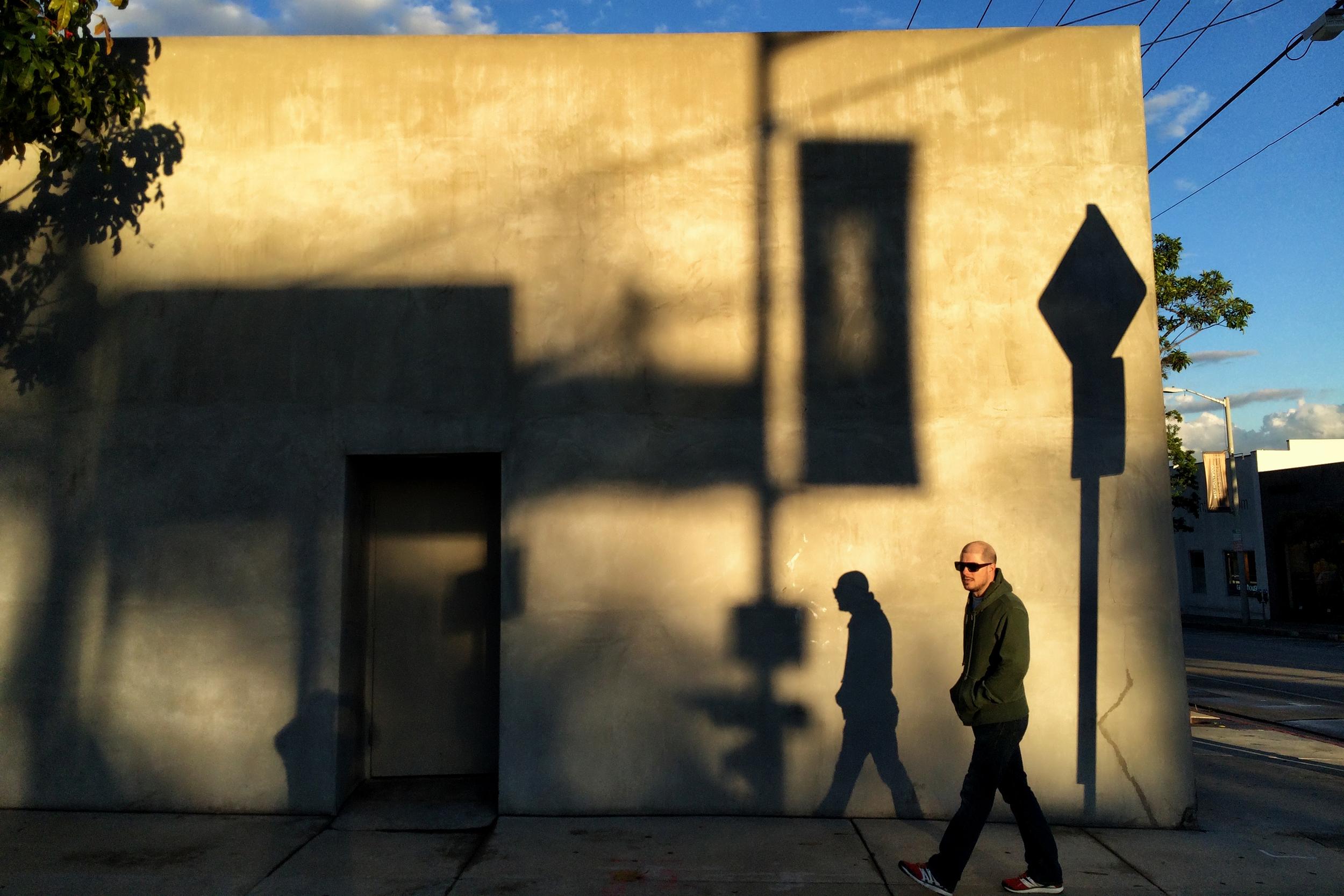 man-walks-down-melrose-after-a-rain-storm-los-angeles-weho.jpg