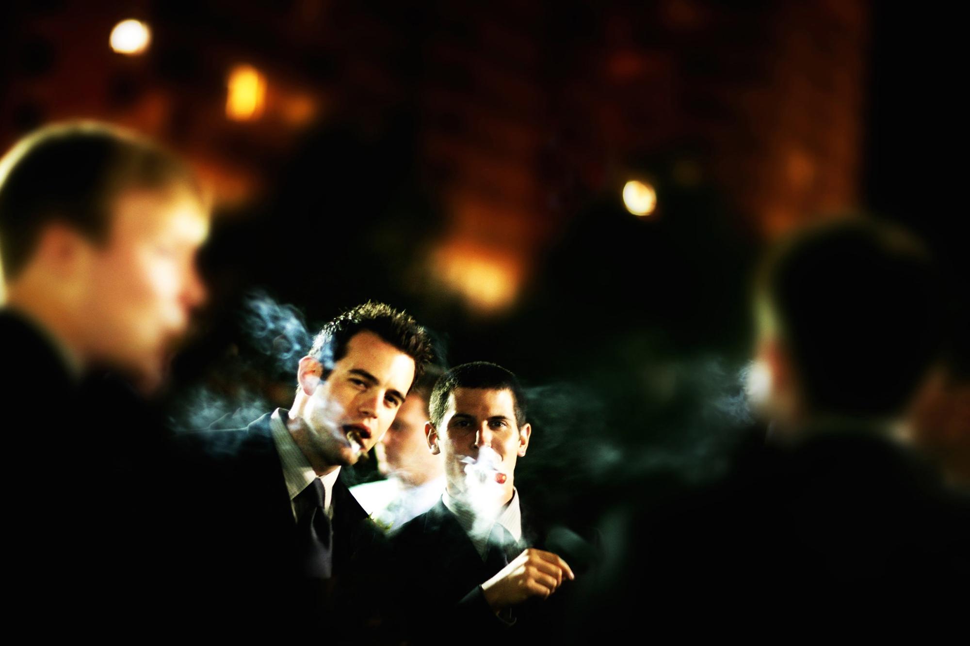 two-young-men-smoke-cigars-mca-chicago-gala.jpg
