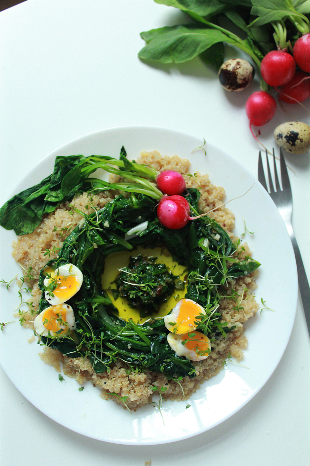 Quinoa & bulgur salad with spinach, chards, radishes, soft-boiled eggs and capper pesto (via inwhirlofinspiration.com)