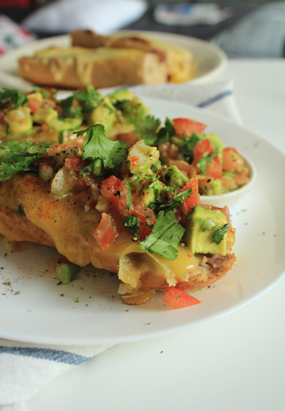 Molletes: bruschettas alla Mexico with melted cheese, avocado, tomato and lots of coriander | by IN WHIRL OF INSPIRATION
