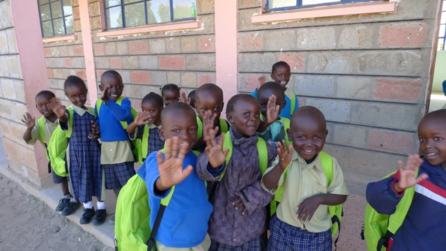 Students in Kenya with their school kits