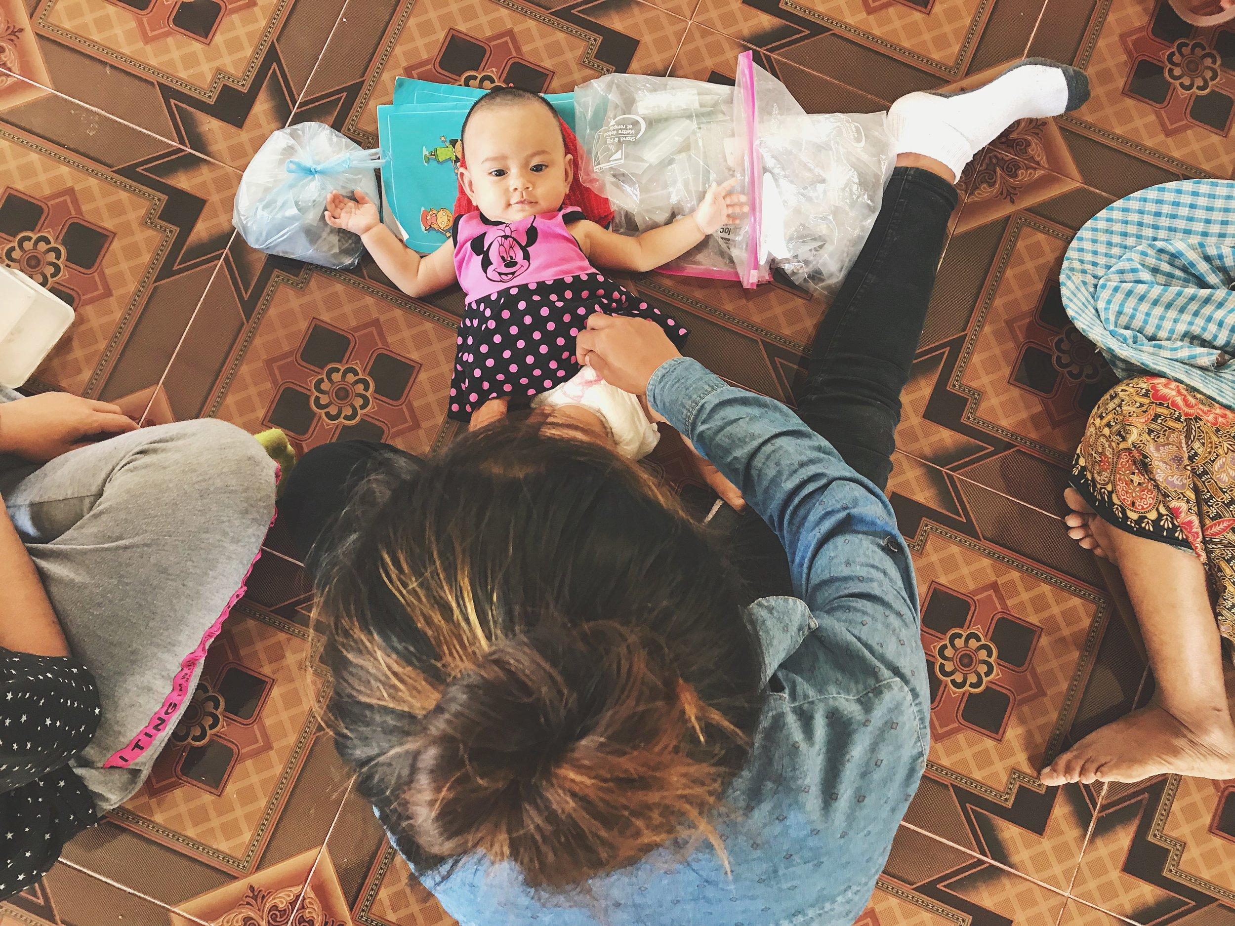 Artisan Srey Mom takes care of her baby born in September 2018.