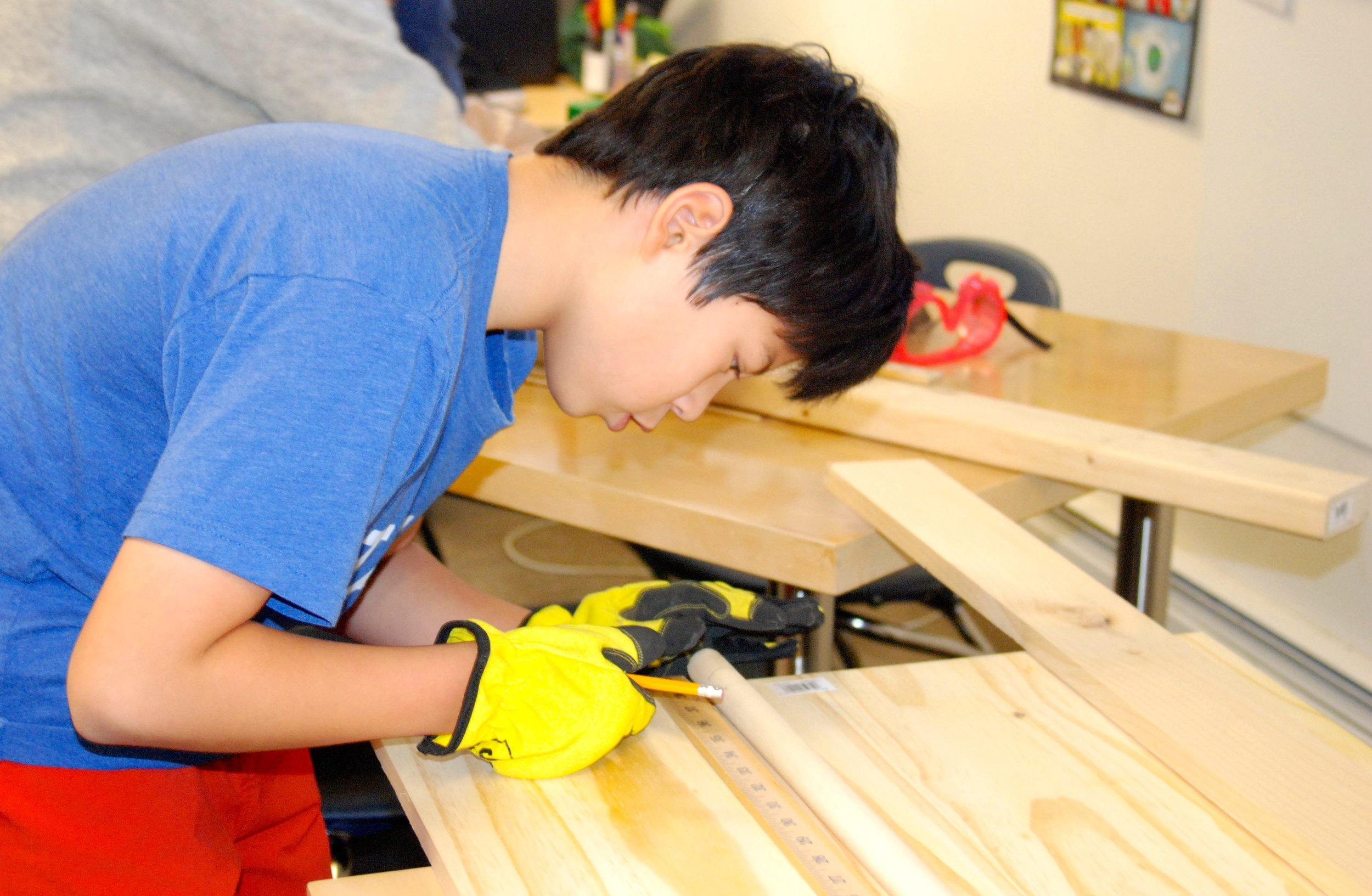 Atrium middle schooler working on a Service Learning project.