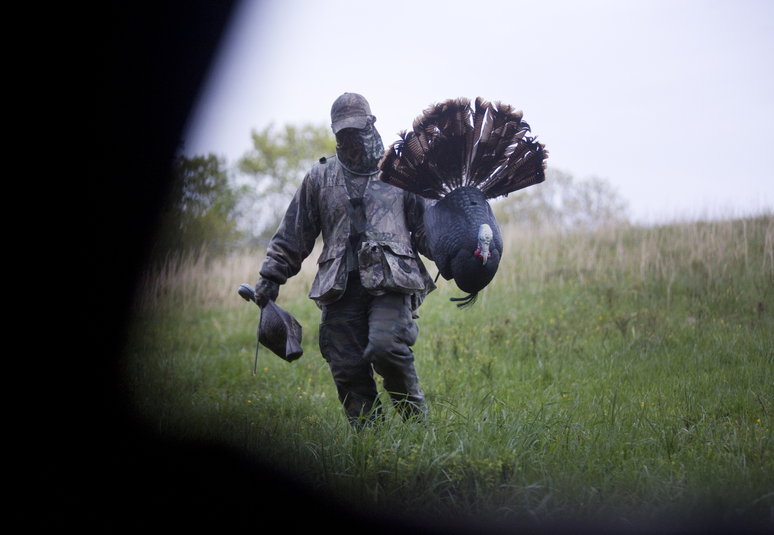 Steve Davenport of Bedford moves the decoys and gets ready to pack up and move to another location. Davenport sat outside in the rain for the entire hunt using a box call trying to entice a gobbler.