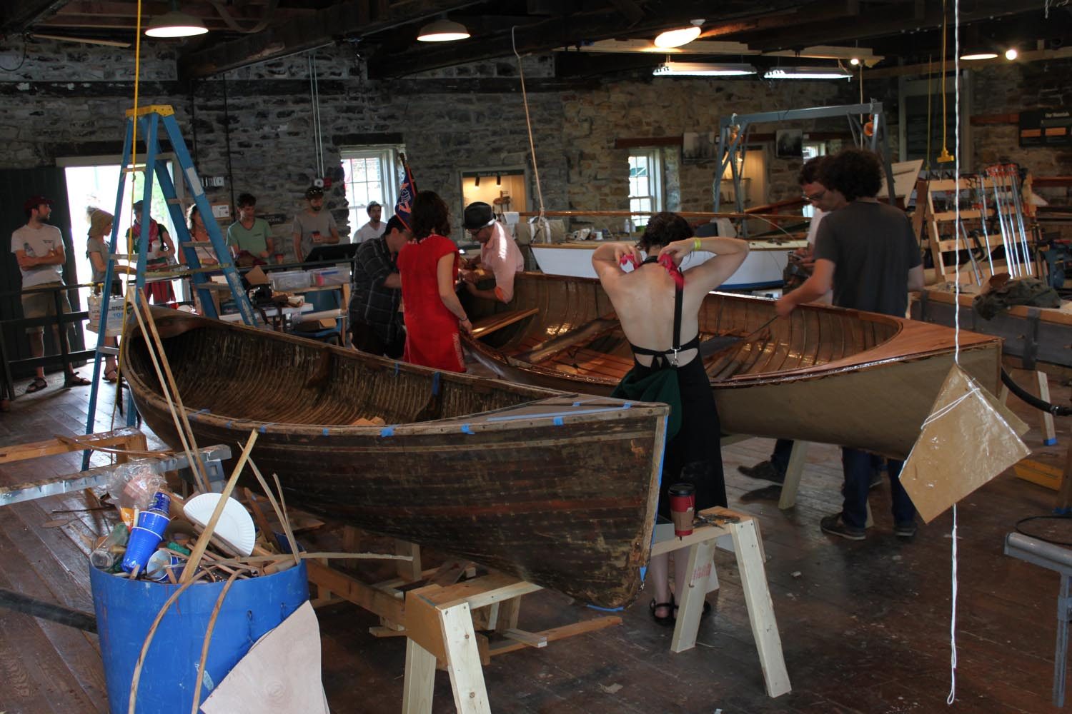 The paper boat and the Peterborough skiff side by side