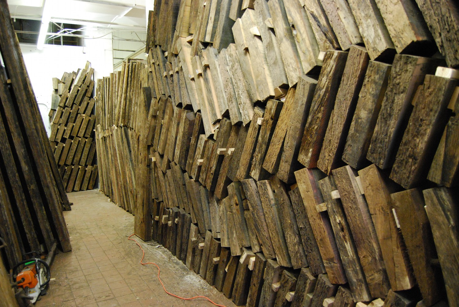 Salvaged planking stacked to dry in Grade's studio