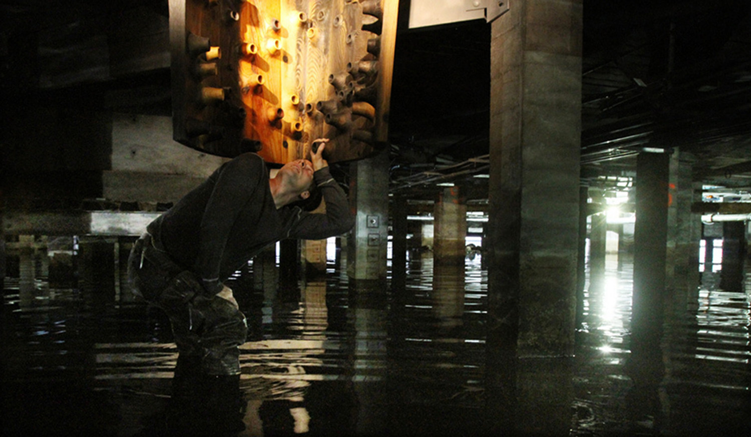 John inspecting lower parts of the sculpture, under the floor of the Armory