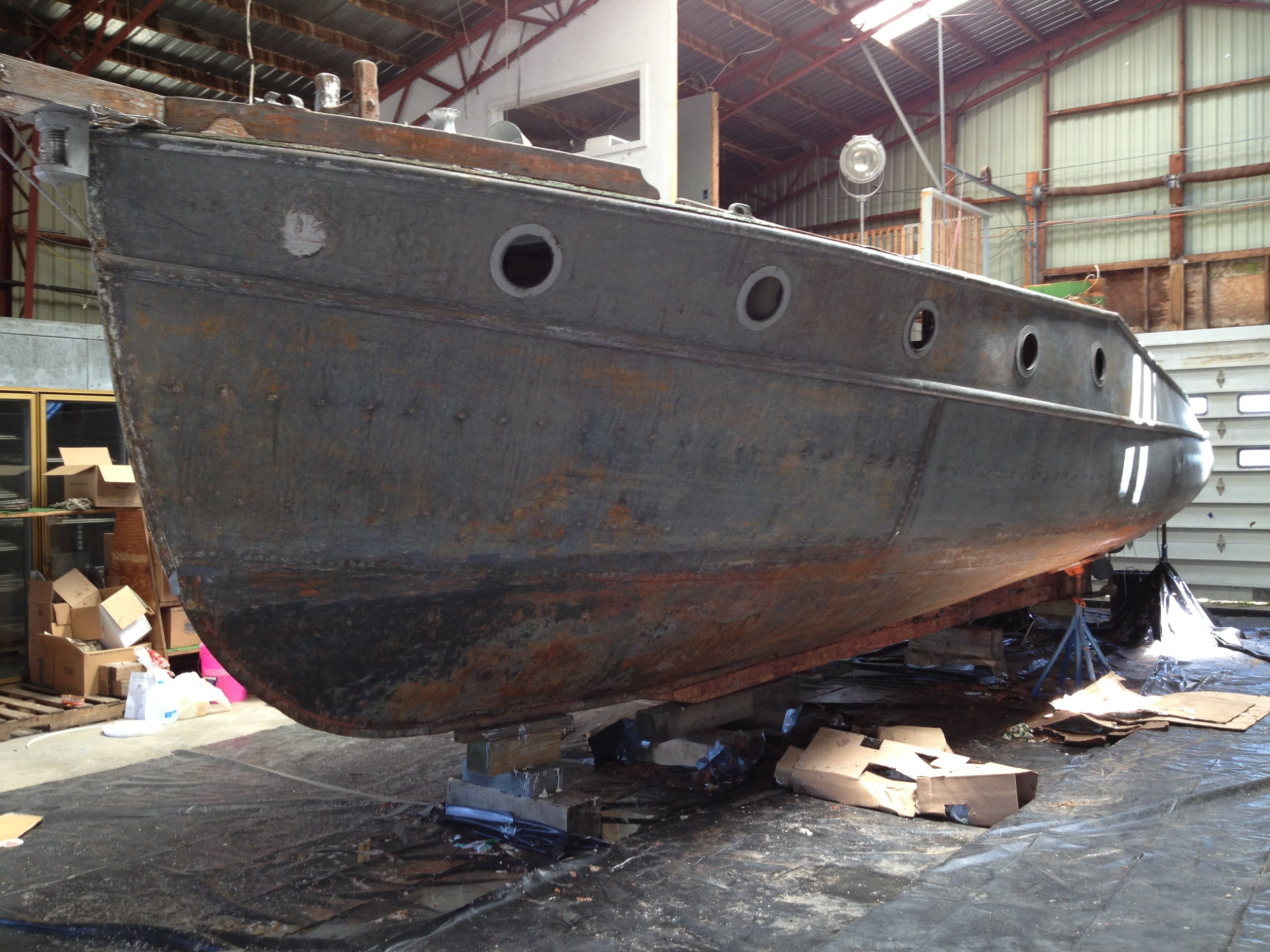 The galvanized iron hull, stripped of the old paint.