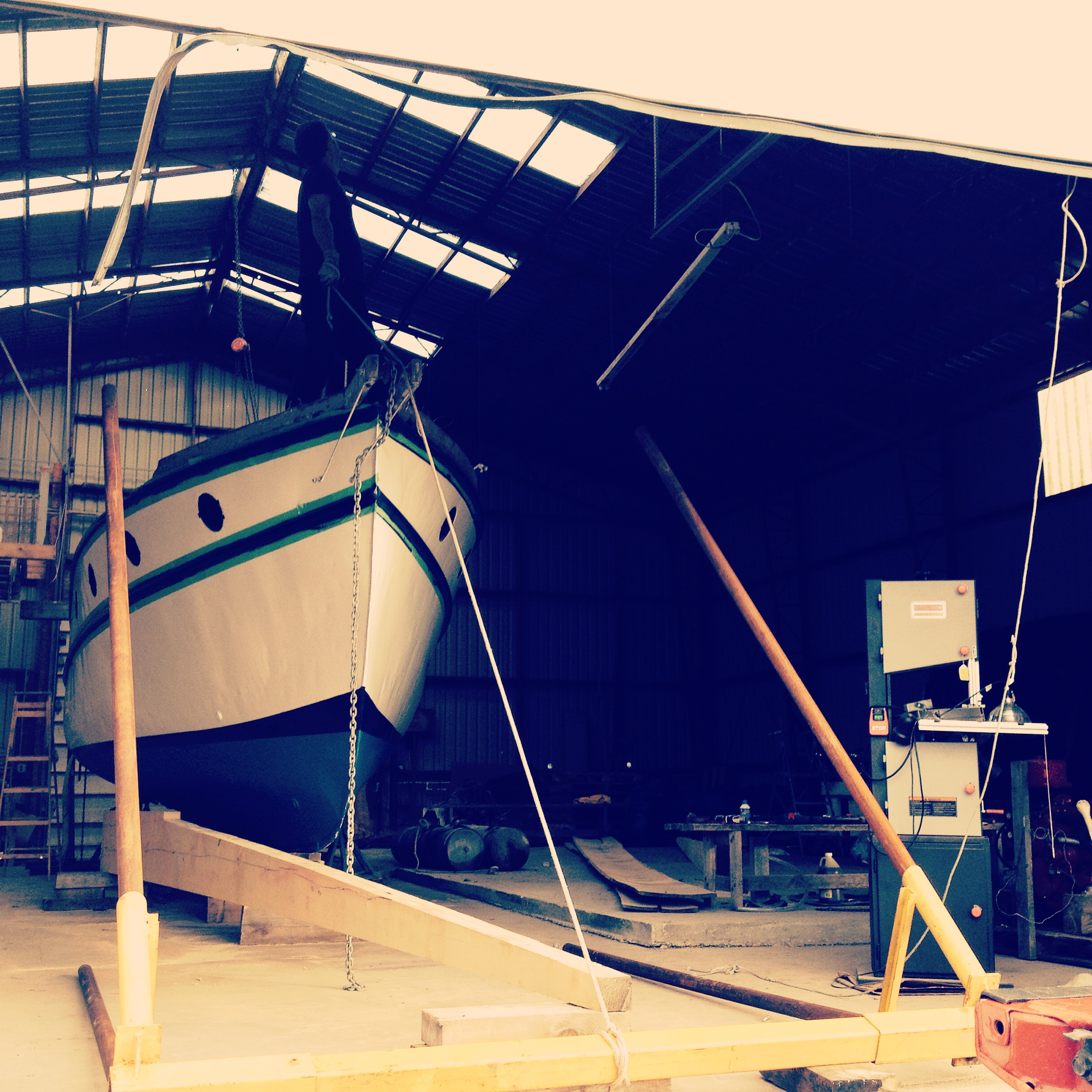 In the shop, preparing to lift the hull for the new keel.