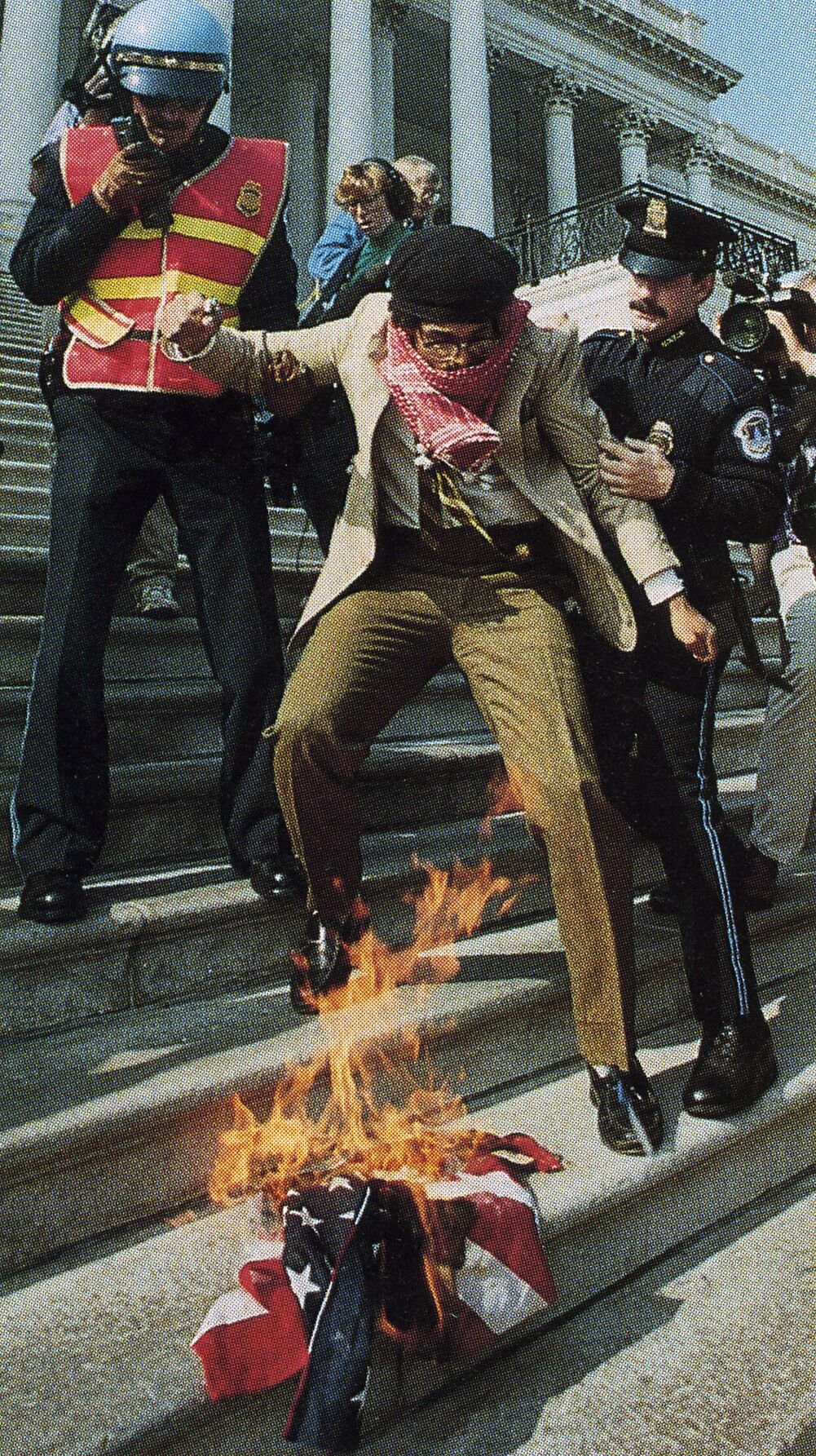 Dread Scott burning the American FLag on the steps of the U.S. Capitol, October 30, 1989, photograph by Charles Tasnadi, AP