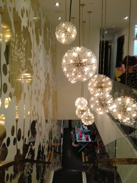 Kate Spade Honolulu. Beautiful Starburst light fixtures and awesome gold foil wall paper.