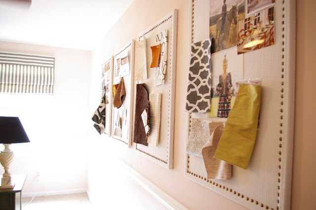 Or turn an ordinary cord board into something beautiful with linen fabric and decorative nail heads.