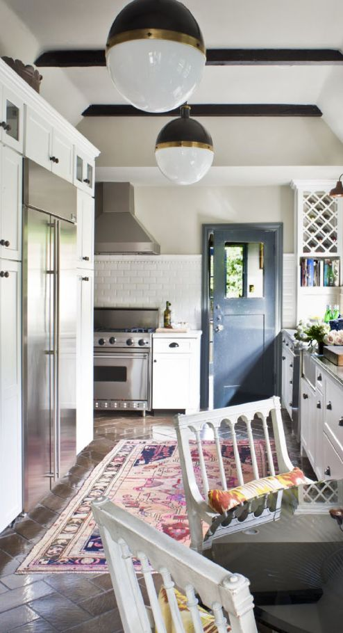 Everything about this kitchen is lovely, including the door.