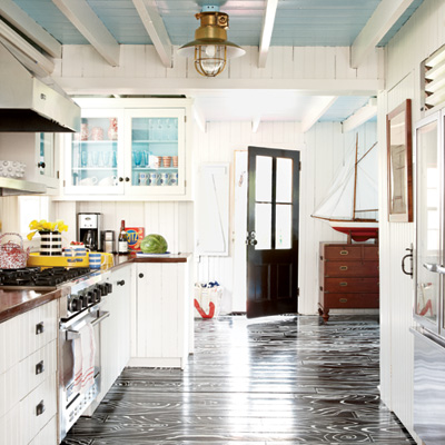 Very bold floors, but it works well in this eclectic beach cottage.