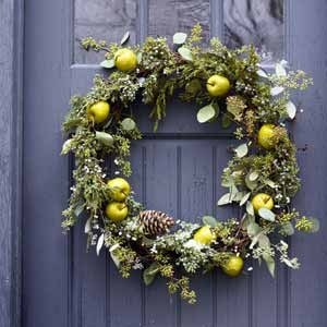 This one has a lot of elements to it (that normally I wouldn't like), but the wreath-maker kept it monochromatic, with an interesting pop of color in the green apples.