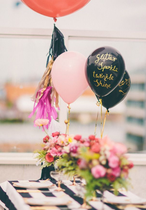 Make inexpensive mylar balloons shine with a metallic paint pen and a beautiful script (tip: recruit your friend with the best handwriting) shown here via  Hello May .