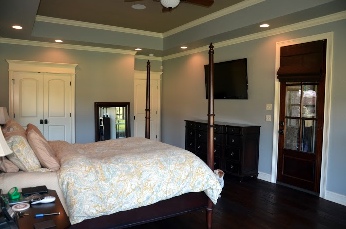 The double doors lead to their gorgeous master bath (with a cooper tub!) and the door to the right of that is the one entering the bedroom  .
