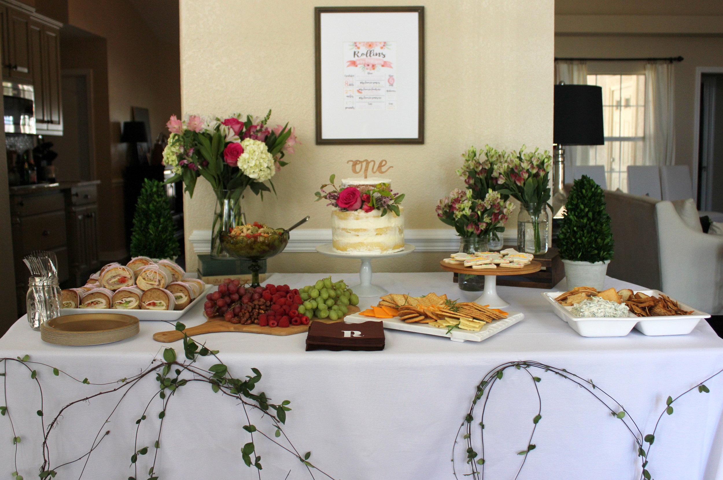 floral first birthday food table