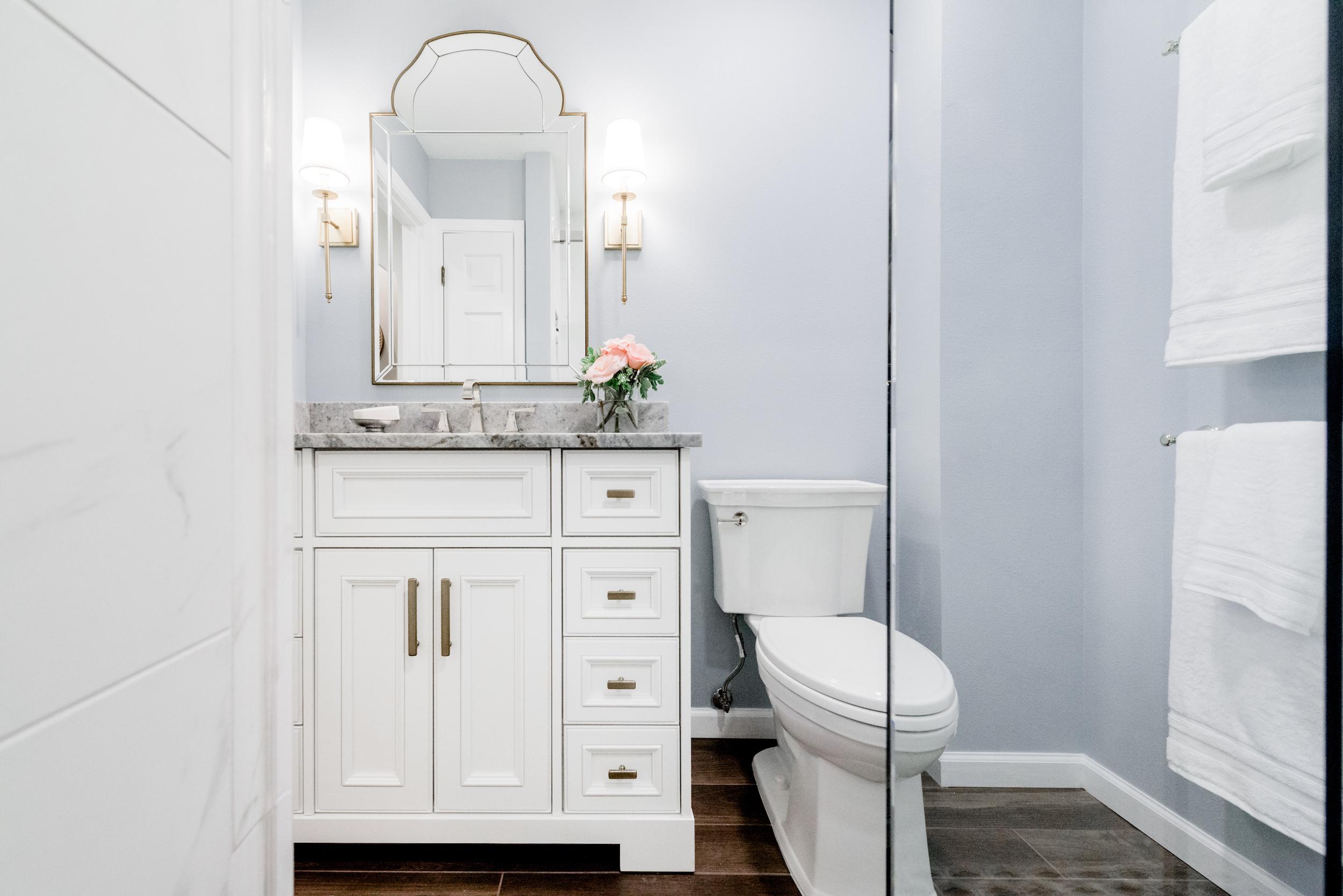 light blue bathroom with white vanity.jpg