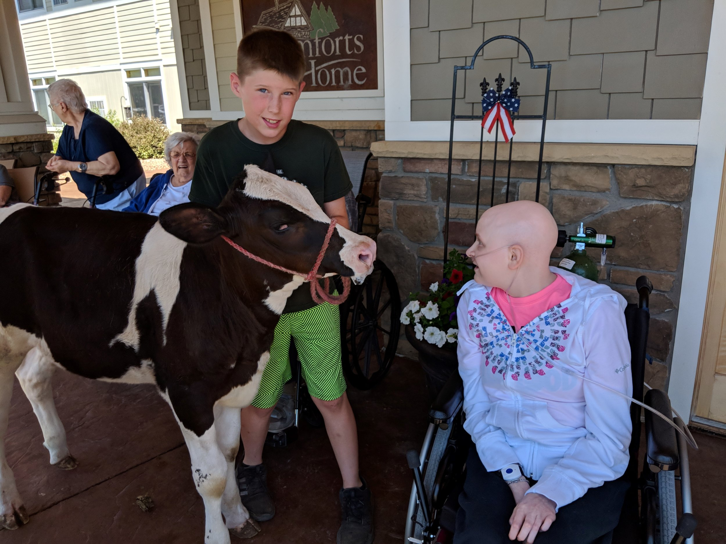 A visit from a fair calf & a donkey!! Thank you Courtney for sharing your time and animals with our tenants! 1.jpg