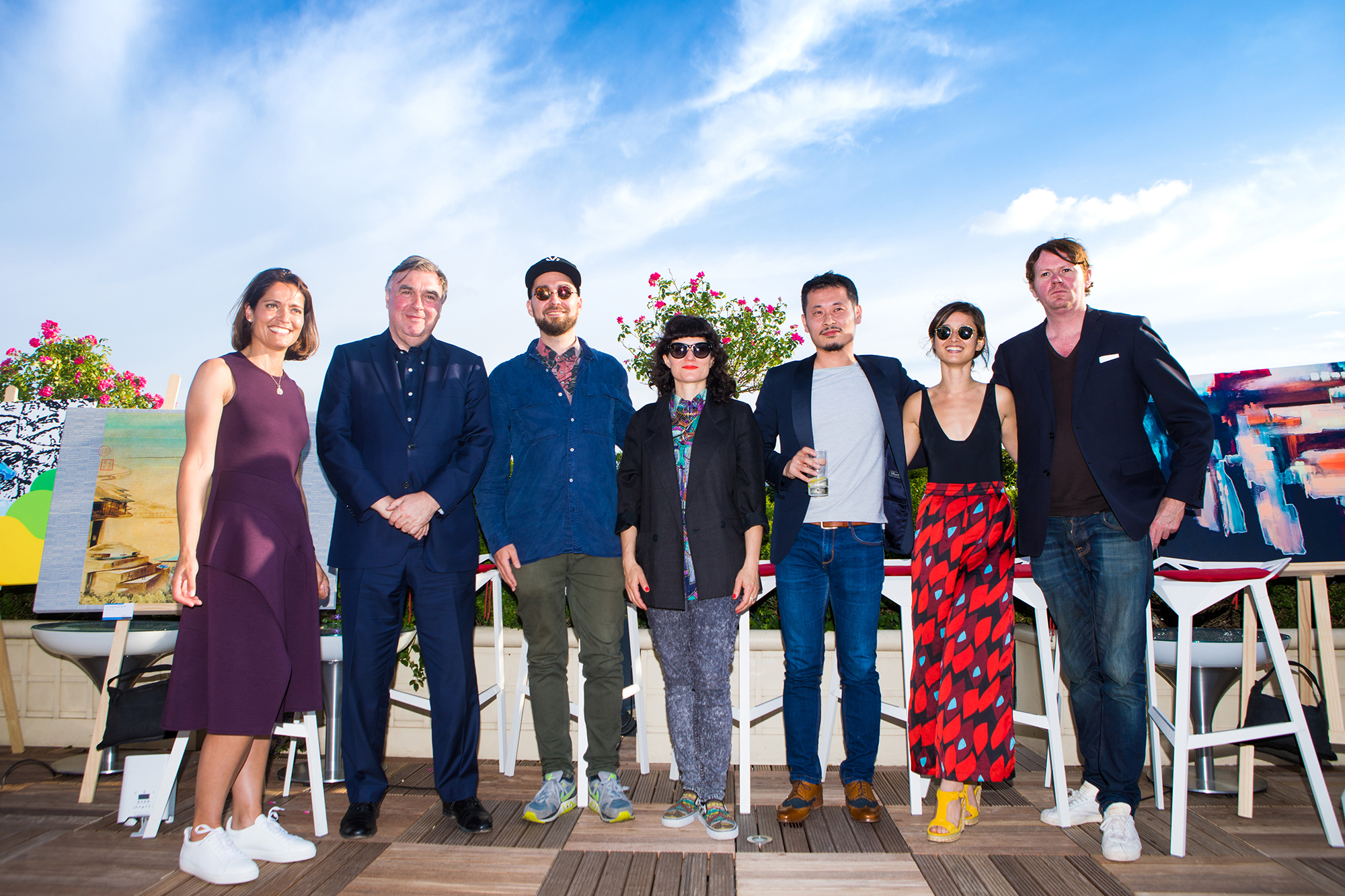 "Group photo of artists and panel of ""Where East and West Meet in Art & Design"" for the Geely  exhibition in Paris, June 2019."