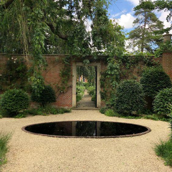 cottesbroke-hall-circular-pool-reflective-pond-garden.jpg