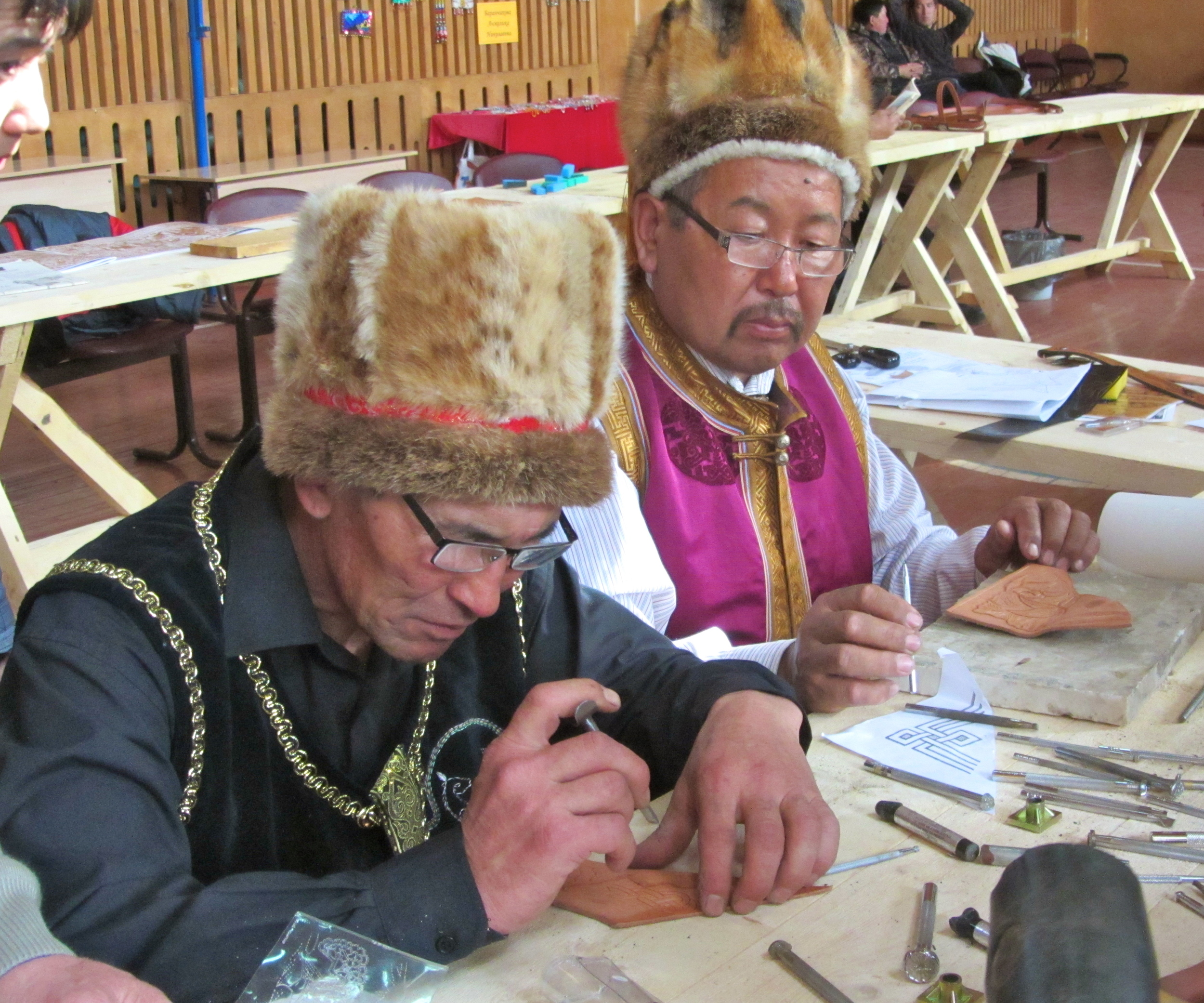 Two Altai saddlemakers working with their new tools.