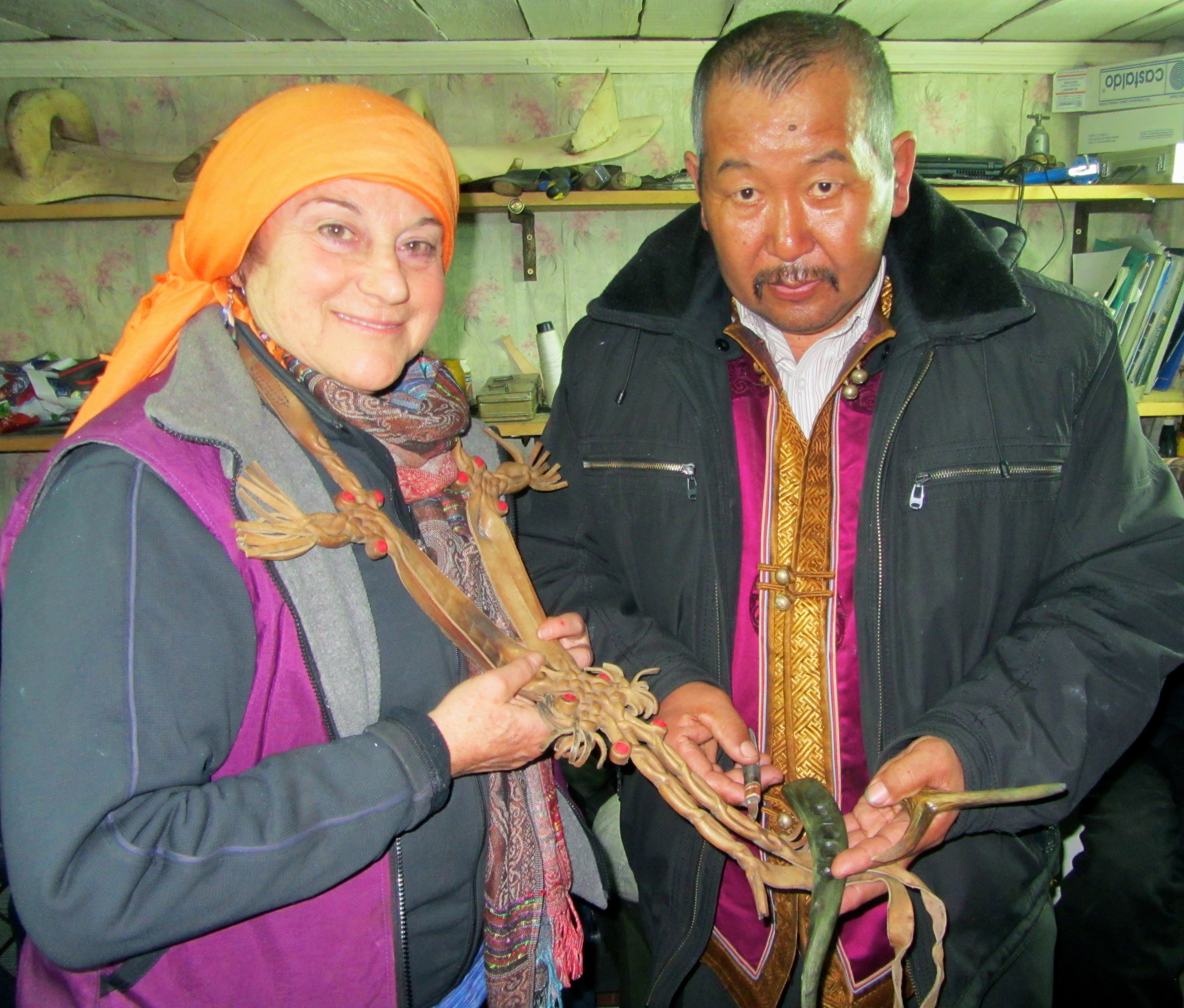 Lisa is gifted some traditional Altai leather work.