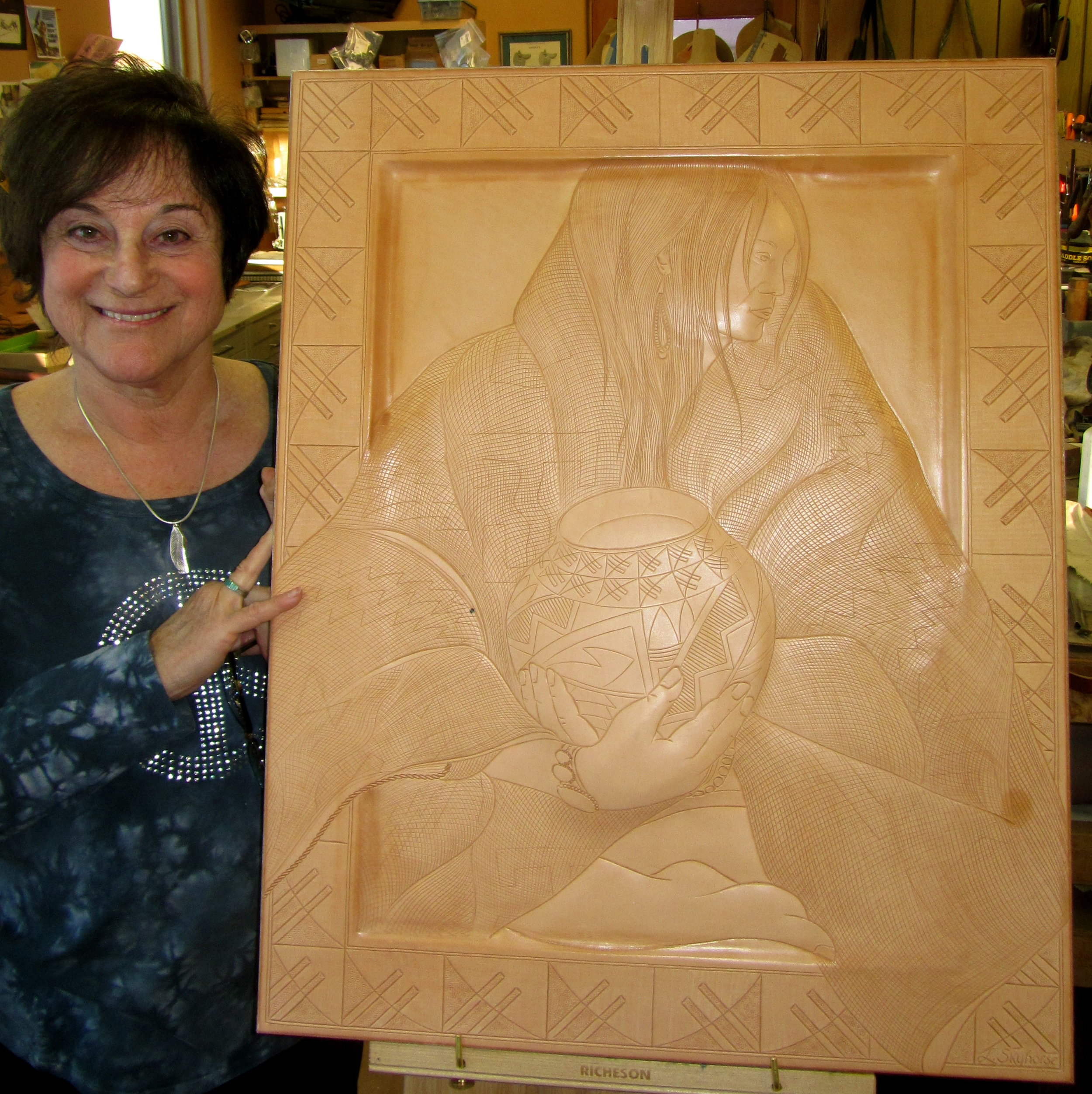 Leather carved, sculpted, and formed into frame.......ready for painting