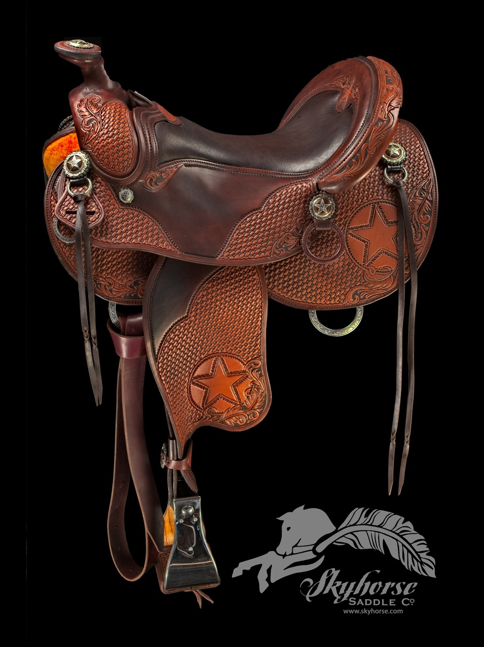"""""""Cowboy Star""""…full quarter bars…17"""" seat…4 1/2"""" cantle…hand stamped basket design with carved western scroll…sterling overlay conchos.      call for price"""