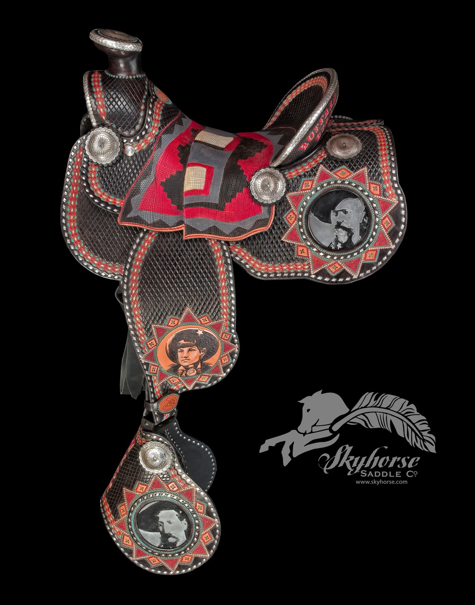 """""""  Buffalo Bill and Friends"""" This collection saddle features carving and hand tooling that is intricately hand painted. The beaded look is accomplished one dot at a time. Notice the carved seat piece that replicates a Navajo woven blanket from 1890…the height of the Wild West Show. The aluminum plate portraits are hand engraved to copy old high resolution photos. Then Lisa carved into the leather fenders additional portraits in the same style. The left side of the saddle showcases """"Wild Bill Hickock"""", """"Annie Oakley"""", and """"Buffalo Bill"""". The right side showcases his native friends; """"Yellow Shirt"""", """"Sitting Bull"""", and """"Ouray"""". All the silver is FINE (.999) and used for the braided edges, and buck stitching. 800 hours was dedicated to this one-of-a-kind creation. Comes with stand and ready to display.      Price: $48000.00"""
