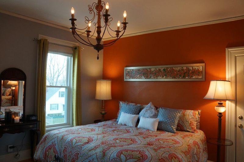 cheryls_room_orangewall_bed.jpg