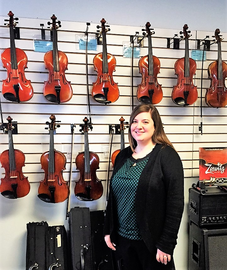 Sonya Hoffman with some of Zeswitz Music's step-up Violin inventory in their Reading, PA Showroom