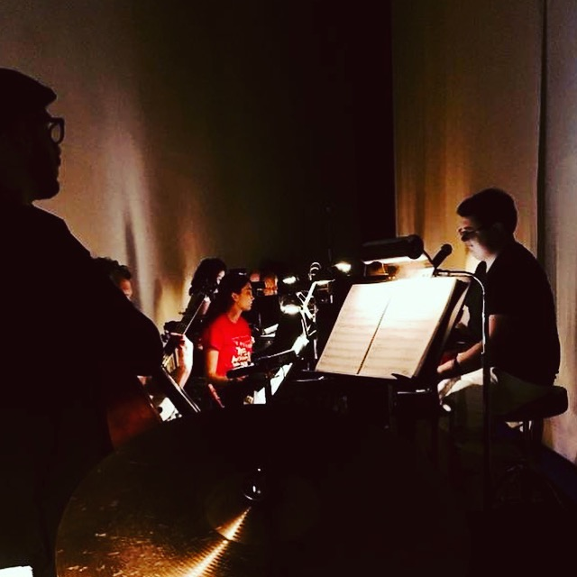 "Conducting the band for ""Thoroughly Modern Millie"" backstage at Meadow Brook Theatre."
