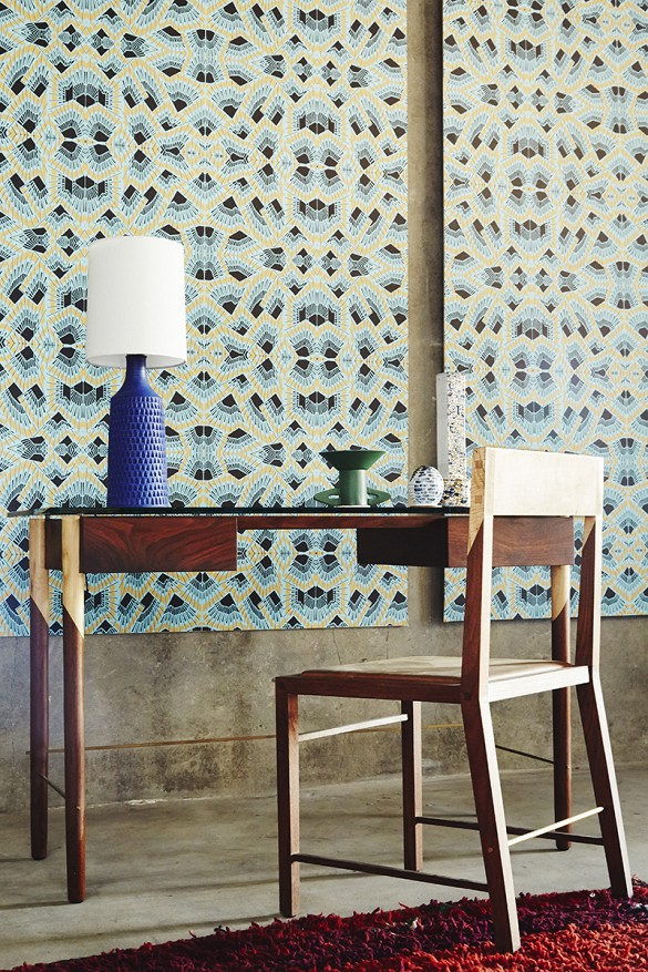 WRITING DESK STYLED IN FRONT OF  WOLFUM  WALLPAPER.