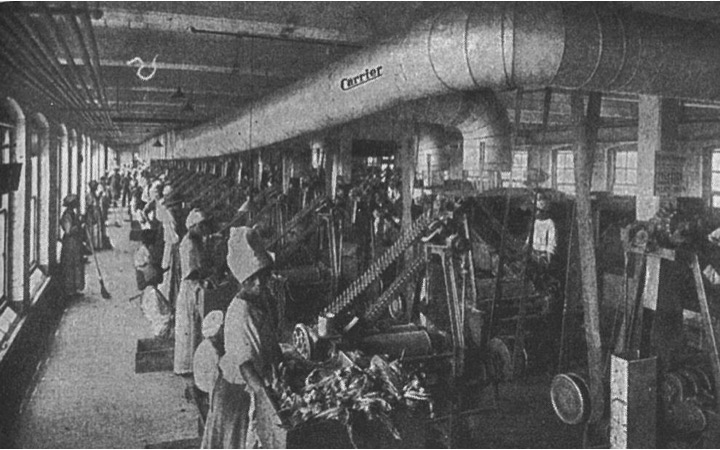 Carrier air-conditioning installed at a tobacco-processing plant to decrease the amount of dust and particles in the air, 1918.