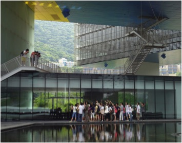 view of the public space below the floating horizontal skyscraper.