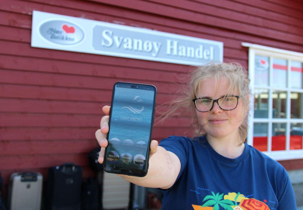 Kvinne viser fram ein mobil