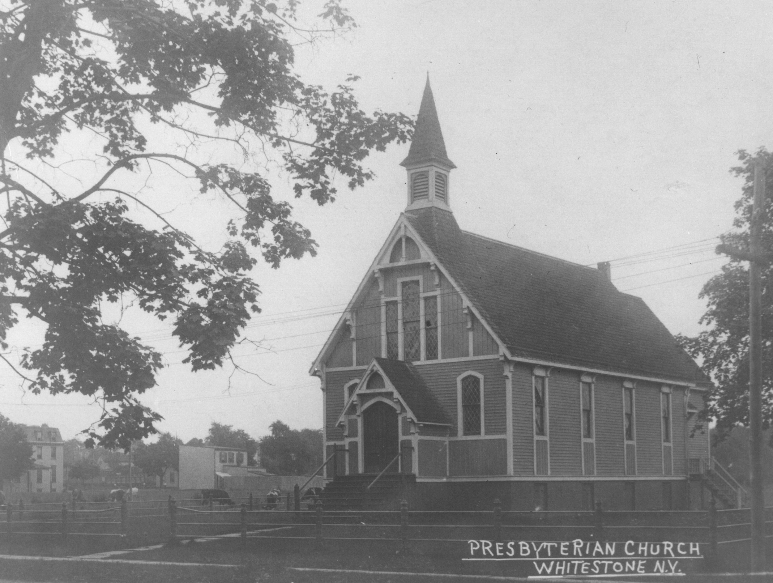The church building in the early 1900s, before the construction of the auditorium. Note the cows grazing just beside the church!