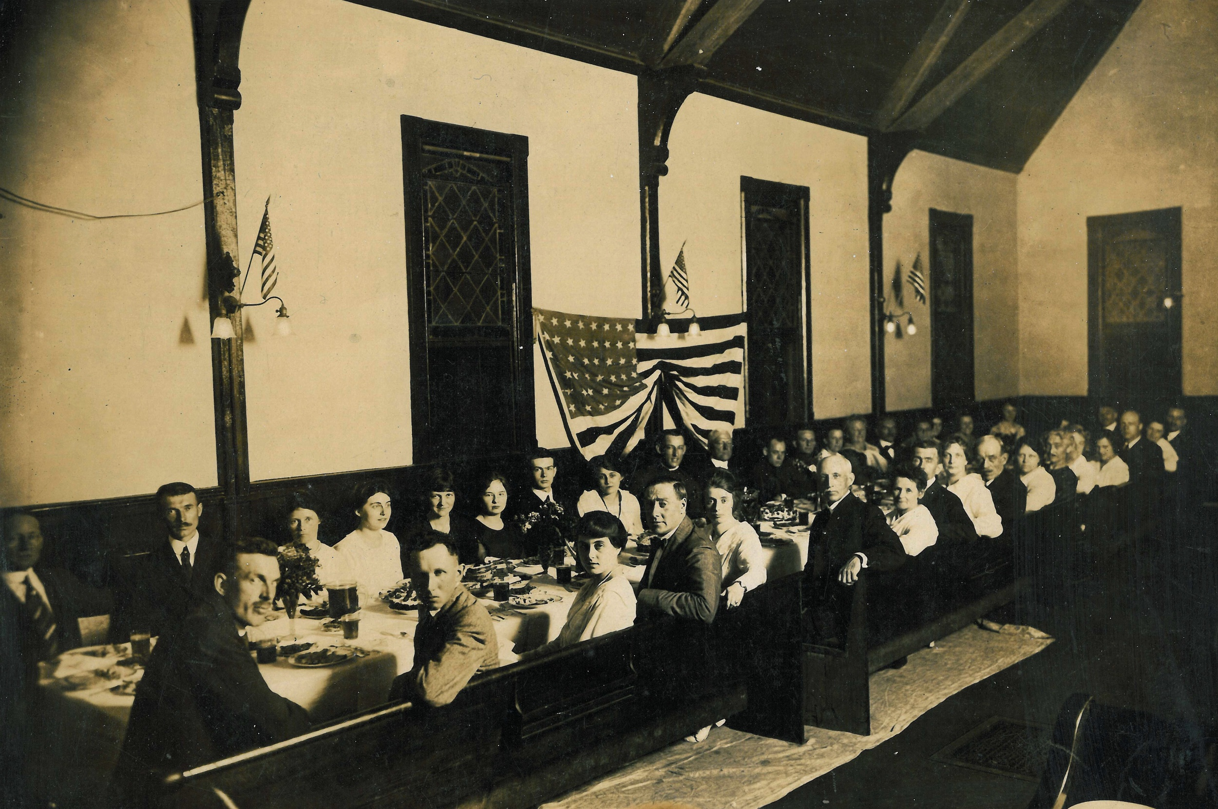 A church dinner in the early 1900s, held in the sanctuary.