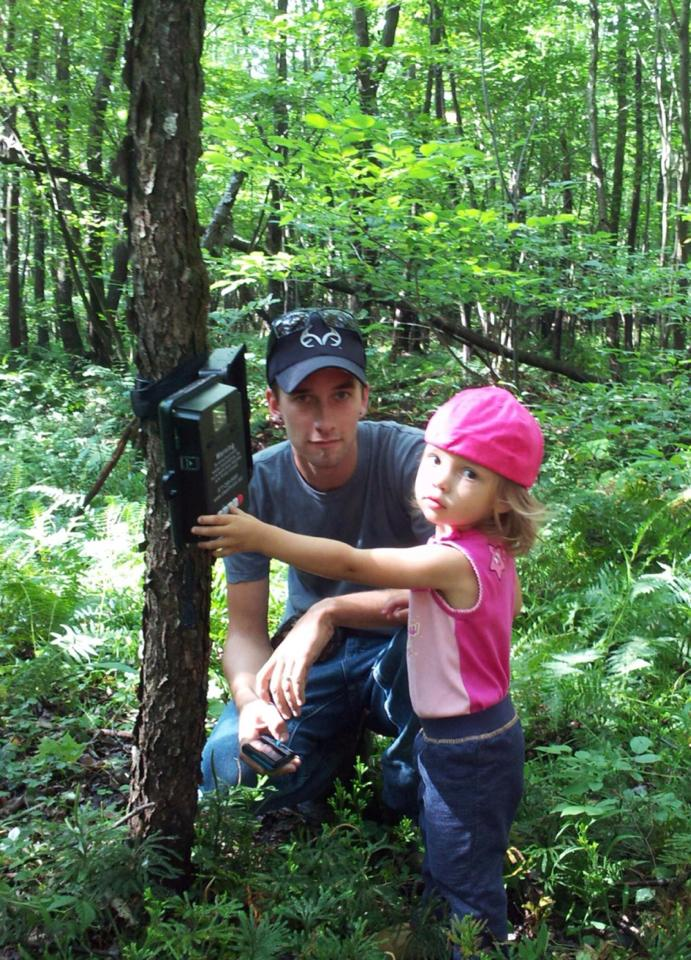 Dad Wade and Addison checking the trailcam
