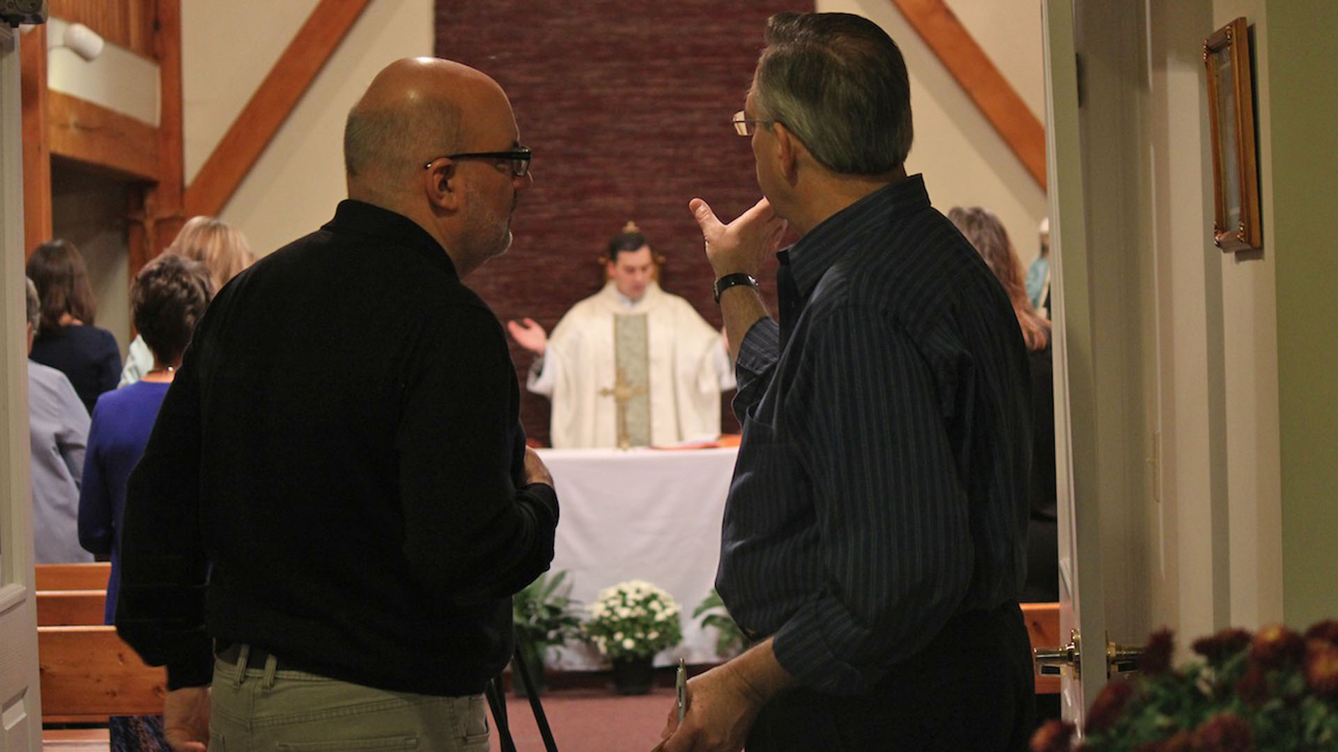 directing fr john in background.jpg